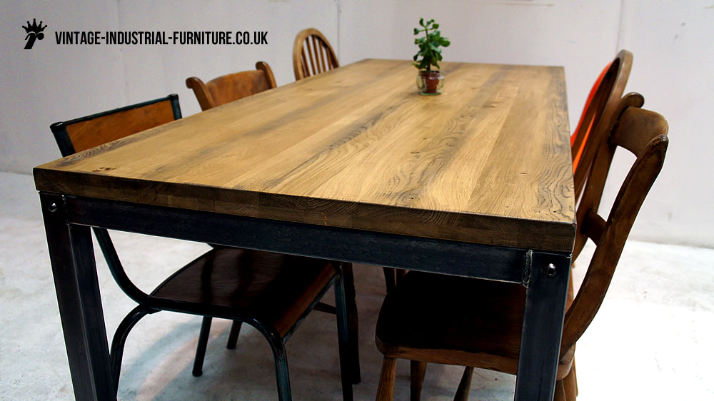 The solid oak dining table featured here has a warm, characterful top.  Supporting this is a substantial welded and bolted steel frame.