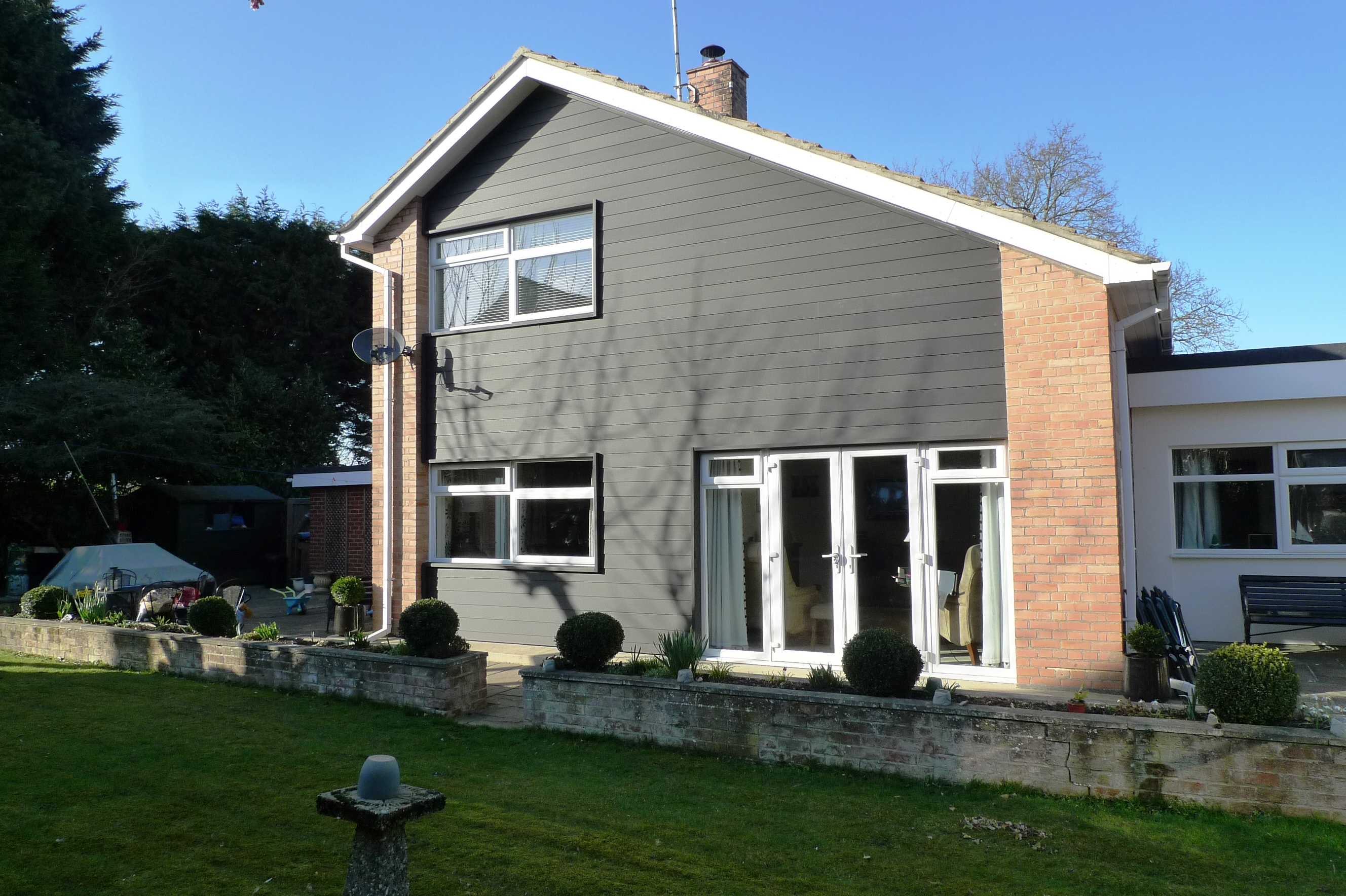 dura cladding project transforms kerb appeal and warmth of 4 bed